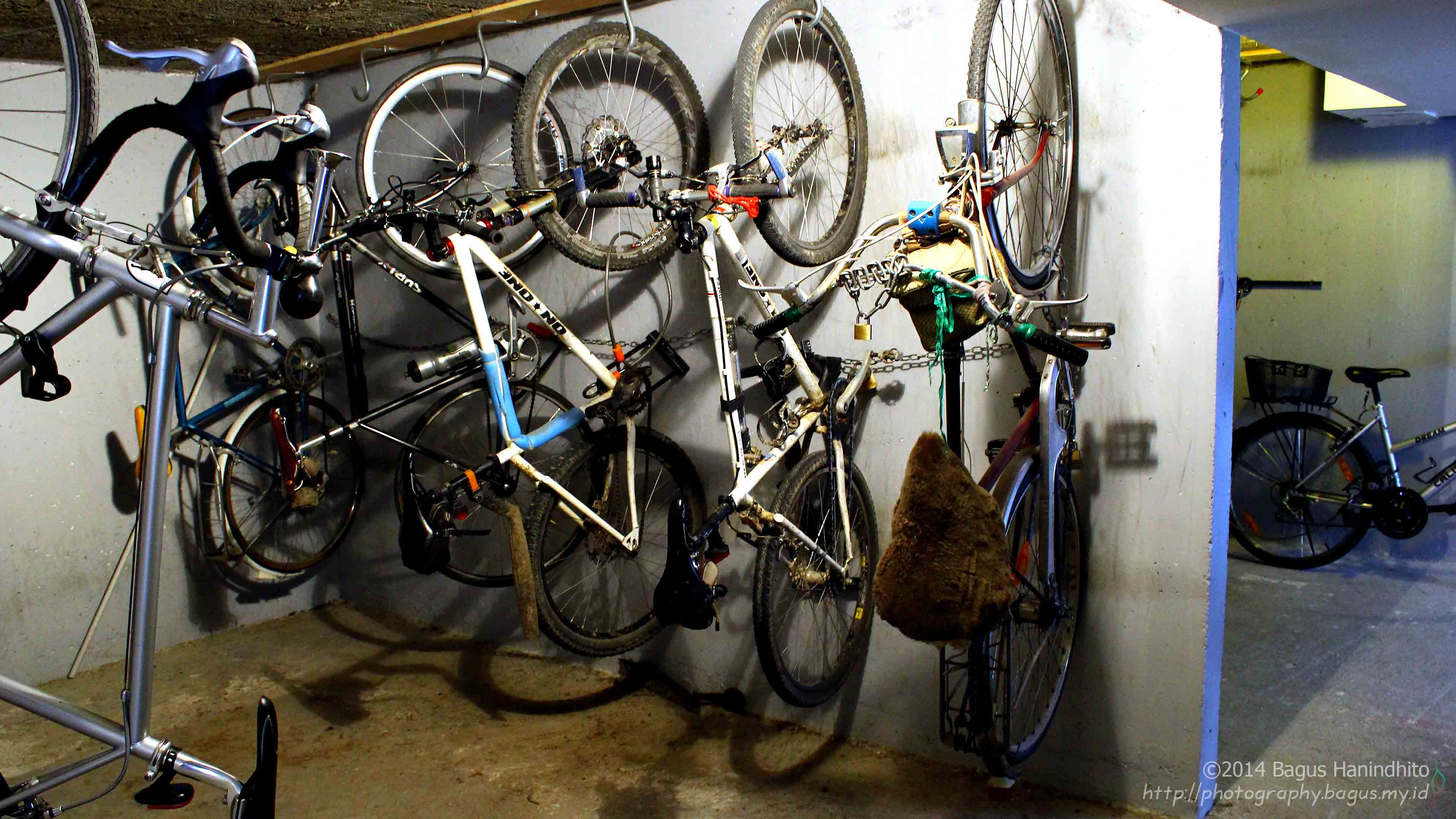 The bicycle garage at CERN Saint Genis Hostel. To save the space, the bicycle were parked vertically.