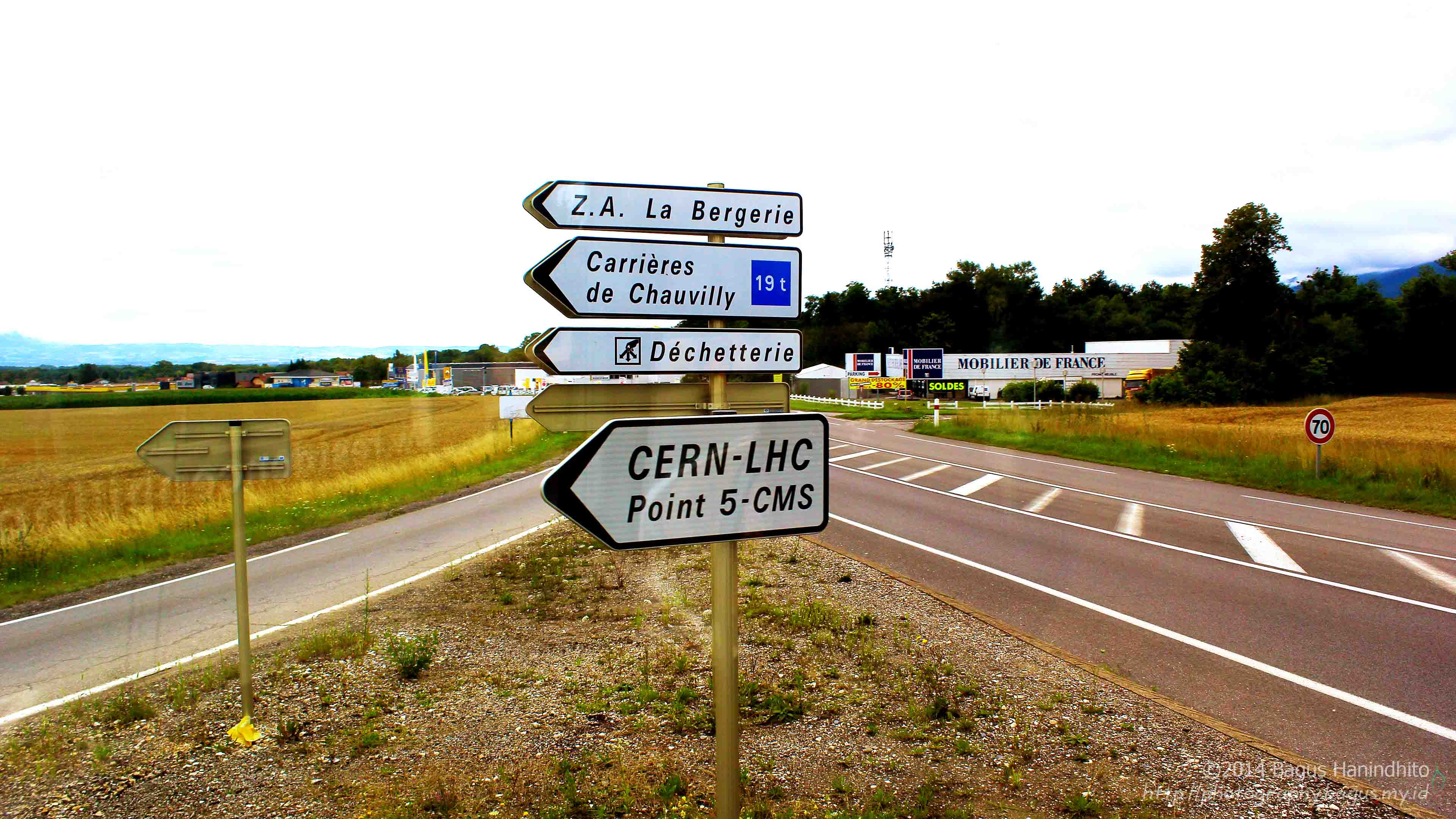 The sign at intersection shows the direction to CERN LHC Point 5 - CMS