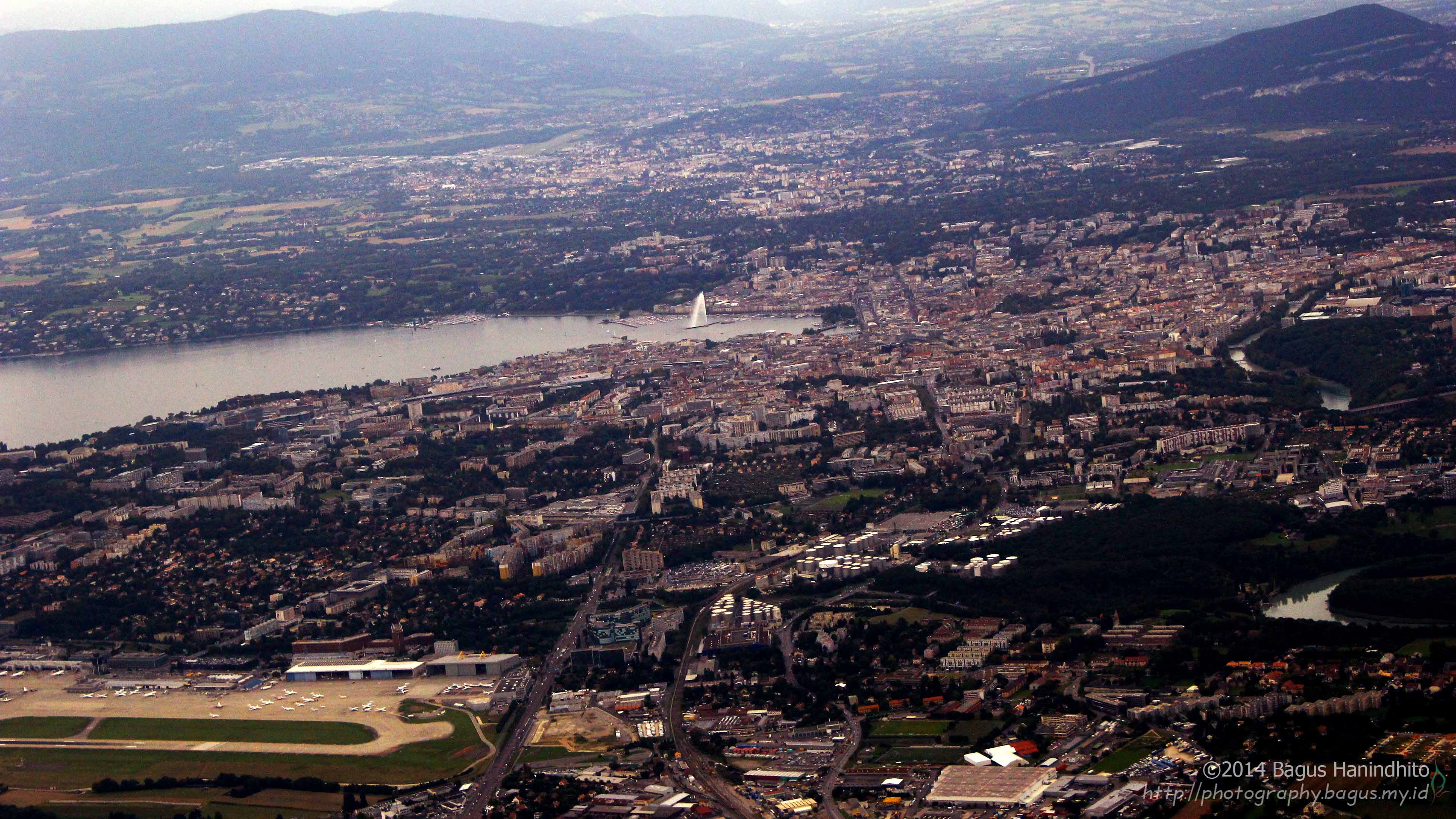The aerial view of Geneva as my plane climbed from GVA airport. You can spot the Geneva Water Jet there. Bye Geneva! Thank you for your hospitality.